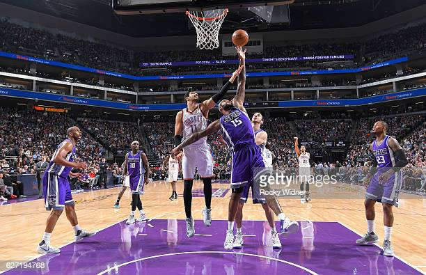 DeMarcus Cousins of the Sacramento Kings rebounds against Enes Kanter of the Oklahoma City Thunder on November 23 2016 at Golden 1 Center in...