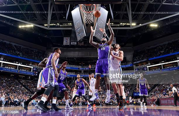 DeMarcus Cousins of the Sacramento Kings rebounds against Steven Adams of the Oklahoma City Thunder on November 23 2016 at Golden 1 Center in...
