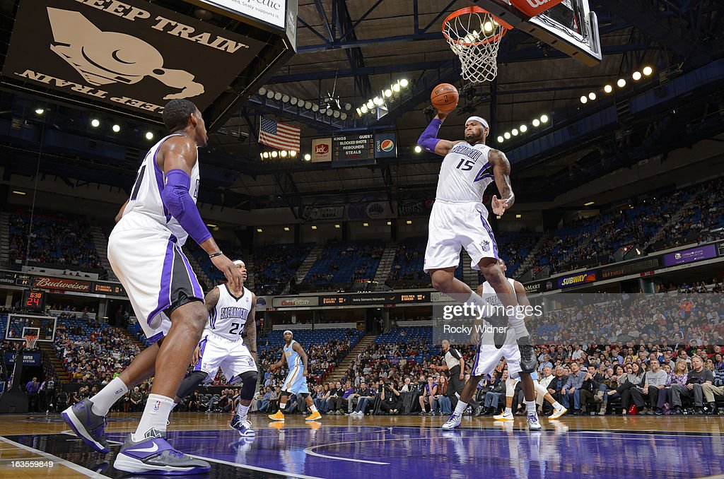 DeMarcus Cousins #15 of the Sacramento Kings rebounds against the Denver Nuggets on March 5, 2013 at Sleep Train Arena in Sacramento, California.