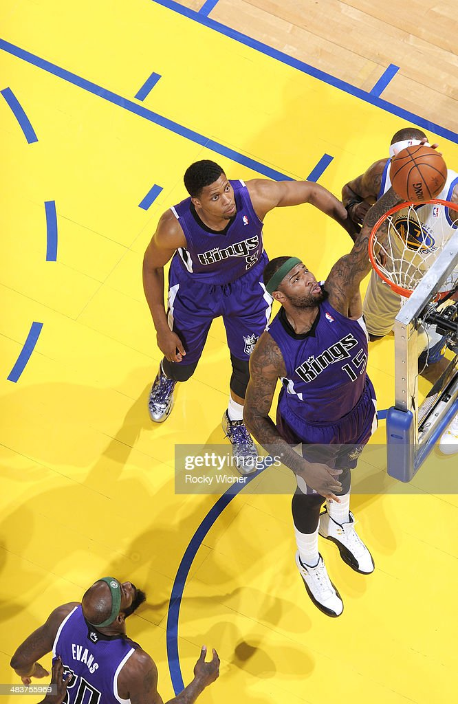 DeMarcus Cousins #15 of the Sacramento Kings rebounds against the Golden State Warriors on April 4, 2014 at Oracle Arena in Oakland, California.
