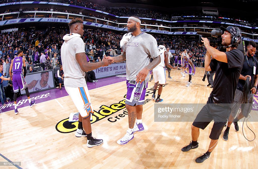 DeMarcus Cousins #15 of the Sacramento Kings shakes hands with Anthony Morrow #2 of the Oklahoma City Thunder on November 23, 2016 at Golden 1 Center in Sacramento, California.