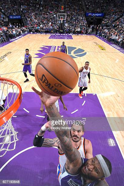 DeMarcus Cousins of the Sacramento Kings shoots a layup against Steven Adams of the Oklahoma City Thunder on November 23 2016 at Golden 1 Center in...