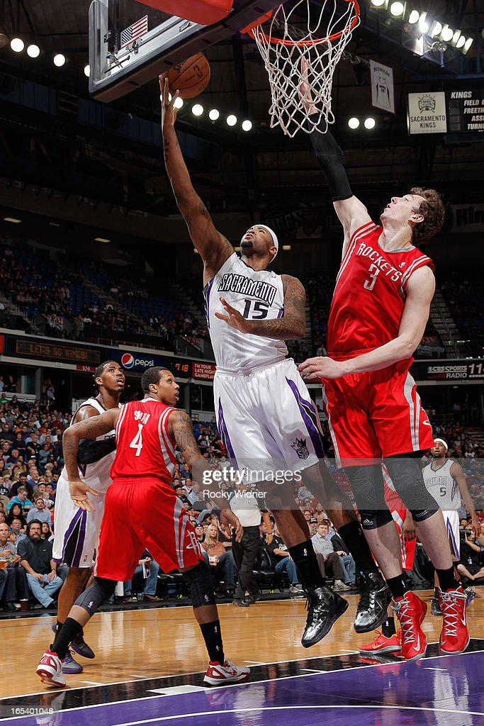 DeMarcus Cousins #15 of the Sacramento Kings shoots a layup against Omer Asik #3 of the Houston Rockets on April 3, 2013 at Sleep Train Arena in Sacramento, California.