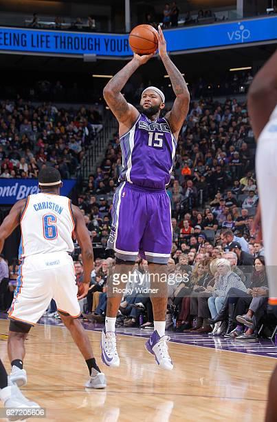 DeMarcus Cousins of the Sacramento Kings shoots a three pointer against Semaj Christon of the Oklahoma City Thunder on November 23 2016 at Golden 1...