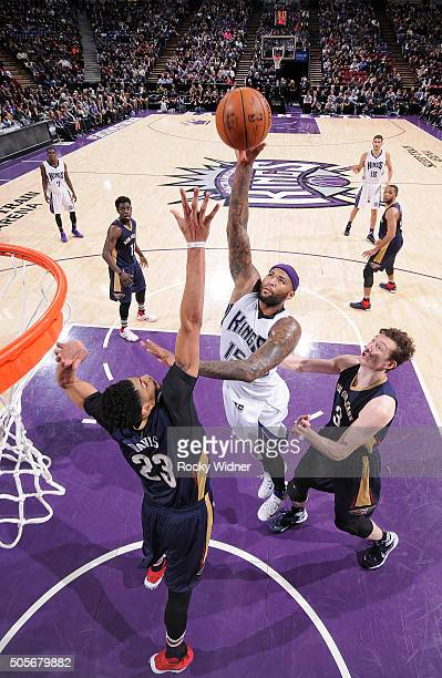 DeMarcus Cousins of the Sacramento Kings shoots against Anthony Davis of the New Orleans Pelicans on January 13 2016 at Sleep Train Arena in...