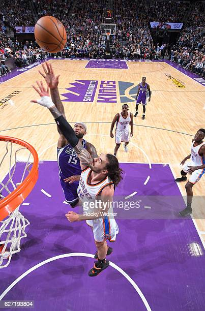 DeMarcus Cousins of the Sacramento Kings shoots against Steven Adams of the Oklahoma City Thunder on November 23 2016 at Golden 1 Center in...