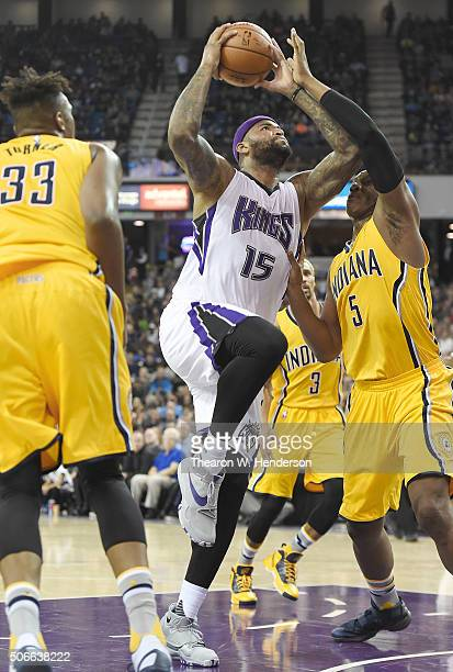 DeMarcus Cousins of the Sacramento Kings shoots over Lavoy Allen of the Indiana Pacers during an NBA basketball game at Sleep Train Arena on January...