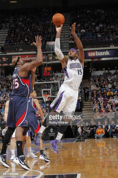 DeMarcus Cousins of the Sacramento Kings shoots the ball against Erick Dampier of the Atlanta Hawks on March 11 2012 at Power Balance Pavilion in...