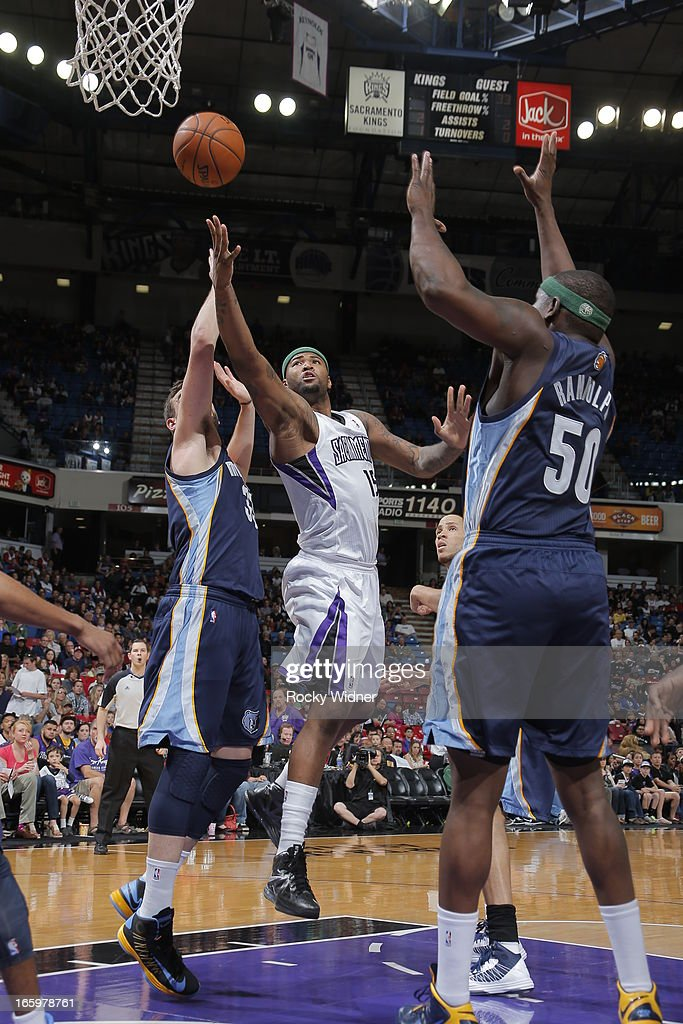 DeMarcus Cousins #15 of the Sacramento Kings shoots the ball against Zach Randolph #50 of the Memphis Grizzles on April 7, 2013 at Sleep Train Arena in Sacramento, California.
