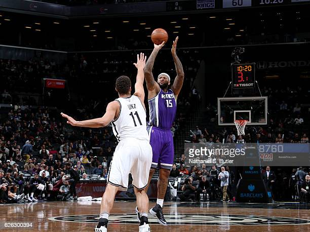 DeMarcus Cousins of the Sacramento Kings shoots the ball over Brook Lopez of the Brooklyn Nets on November 27 2016 at Barclays Center in Brooklyn NY...