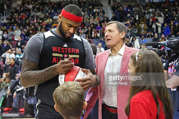DeMarcus Cousins of the Sacramento Kings signs a ball for NBA TNT Analyst Craig Sager during the NBA AllStar Practice as part of 2016 AllStar Weekend...