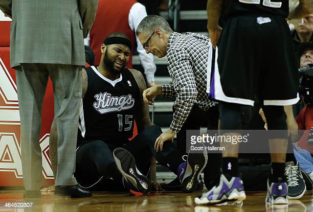 DeMarcus Cousins of the Sacramento Kings sits on the court after a hard foul during the game against the Houston Rockets at the Toyota Center on...