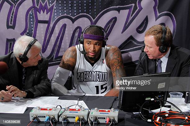 DeMarcus Cousins of the Sacramento Kings speaking to Jerry Reynolds and Grant Napear after a game against the Utah Jazz on February 28 2012 at Power...