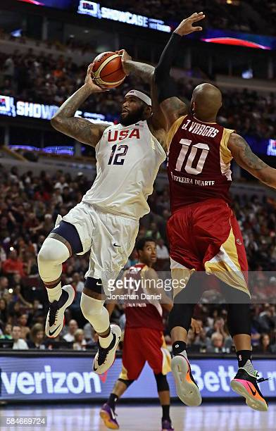 DeMarcus Cousins of the United States goes up for a shot past Jose Vargas of Venezuela during a preOlympic exhibition game at United Center on July...