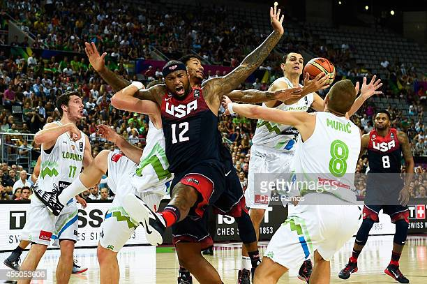 DeMarcus Cousins of the USA Basketball Men's National Team duels for the ball with Slovenia Basketball Men's National Team players during 2014 FIBA...