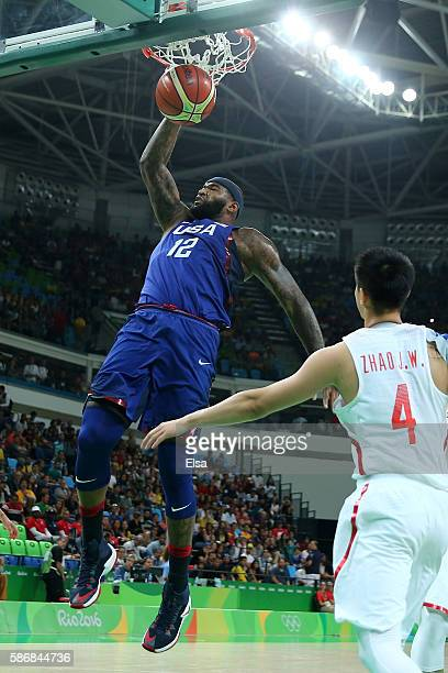 Demarcus Cousins of United States dunks against Jiwei Zhao of China in the Men's Preliminary Round Group A match on Day 1 of the Rio 2016 Olympic...