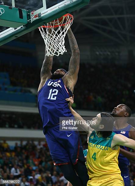 Demarcus Cousins of United States dunks as Chris Goulding of Australia looks on during the Men's Preliminary Round Group A between Australia and the...