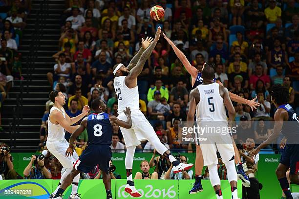 Demarcus Cousins of United States shoots against Joffrey Lauvergne of France during a Men's Preliminary Round Group A game between the United States...