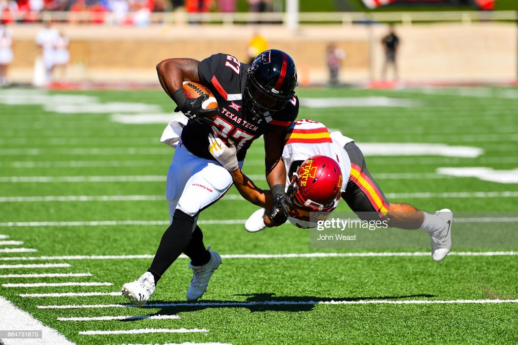 Demarcus Felton #27 of the Texas Tech Red Raiders is tackled by Braxton Lewis #33 of the Iowa State Cyclones during the game on October 21, 2017 at Jones AT&T Stadium in Lubbock, Texas. Iowa State defeated Texas Tech 31-13.