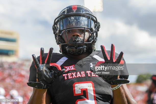 Demarcus Felton of the Texas Tech Red Raiders reacts to scoring a touchdown during the first half of the game against the Lamar Cardinals on...