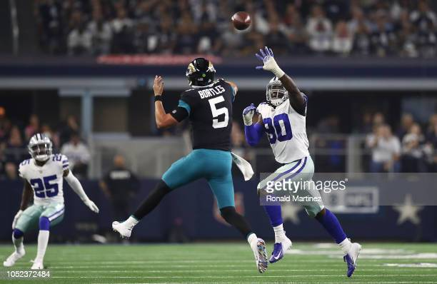 Demarcus Lawrence of the Dallas Cowboys defends Blake Bortles of the Jacksonville Jaguars at ATT Stadium on October 14 2018 in Arlington Texas