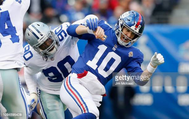 Demarcus Lawrence of the Dallas Cowboys in action against Eli Manning of the New York Giants on December 30 2018 at MetLife Stadium in East...