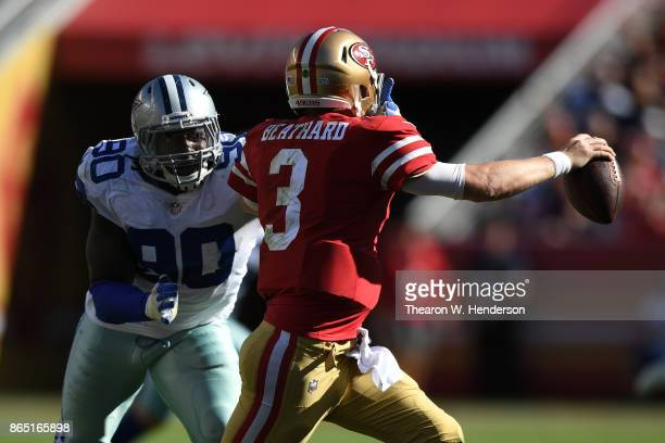 DeMarcus Lawrence of the Dallas Cowboys pressures CJ Beathard of the San Francisco 49ers during their NFL game at Levi's Stadium on October 22 2017...