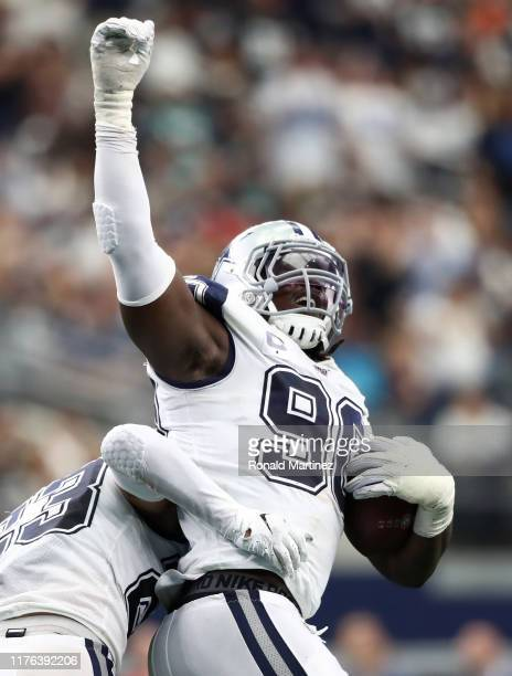Demarcus Lawrence of the Dallas Cowboys reacts after a fumble recovery against the Miami Dolphins in the second quarter at ATT Stadium on September...