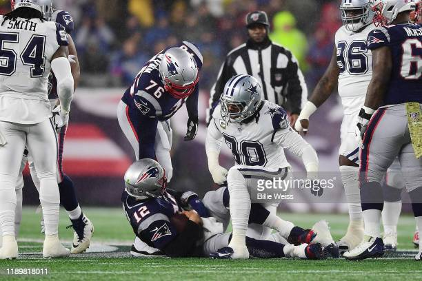 DeMarcus Lawrence of the Dallas Cowboys reacts after sacking Tom Brady of the New England Patriots during the first half in the game at Gillette...