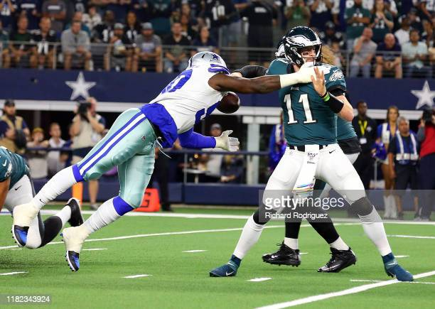 Demarcus Lawrence of the Dallas Cowboys sacks Carson Wentz of the Philadelphia Eagles and forces a fumble in the first quarter at ATT Stadium on...