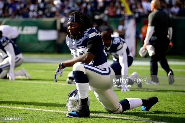 Demarcus Lawrence of the Dallas Cowboys stretches during warm ups prior to the game against the New York Jets at MetLife Stadium on October 13 2019...