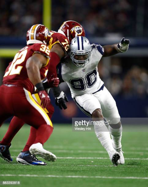 DeMarcus Lawrence of the Dallas Cowboys tries to get around Ty Nsekhe of the Washington Redskins in the second half of a game at ATT Stadium on...