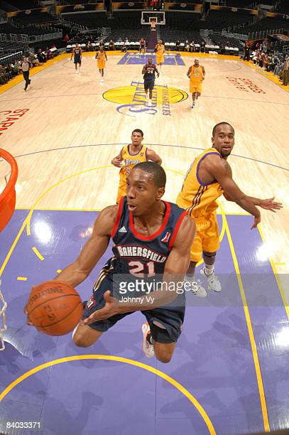DeMarcus Nelson of the Bakersfield Jam goes up for a shot while Joe Crawford of the Los Angeles DFenders looks on during the game at Staples Center...