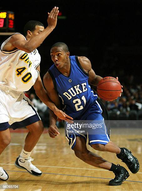 DeMarcus Nelson of the Duke Blue Devils drives to the hoop around Kenny Tribbett of the Drexel Dragons during their Preseason NIT game at Madison...