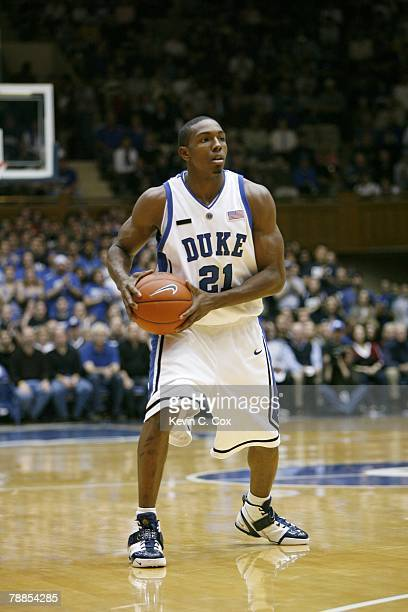 DeMarcus Nelson of the Duke Blue Devils looks to move the ball during the college basketball game against the Cornell Big Red at Cameron Indoor...