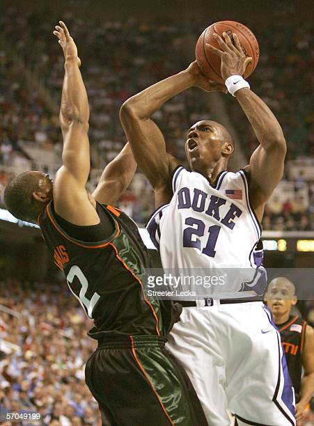 DeMarcus Nelson of the Duke Blue Devils shoots over Raymond Hicks of the Miami Hurricanes during the quarterfinals of the Atlantic Coast Conference...