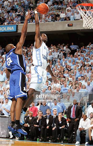 DeMarcus Nelson of the Duke Blue Devils tries to block Jackie Manuel of the North Carolina Tar Heels on March 6 2005 at the Dean E Smith Center in...