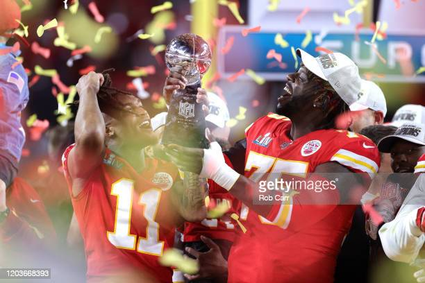 Demarcus Robinson and Cameron Erving of the Kansas City Chiefs celebrate with the Vince Lombardi Trophy after defeating the San Francisco 49ers 3120...