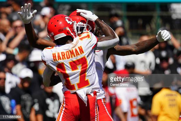 Demarcus Robinson of the Kansas City Chiefs celebrates a touchdown with Mecole Hardman during the second quarter against the Oakland Raiders at...