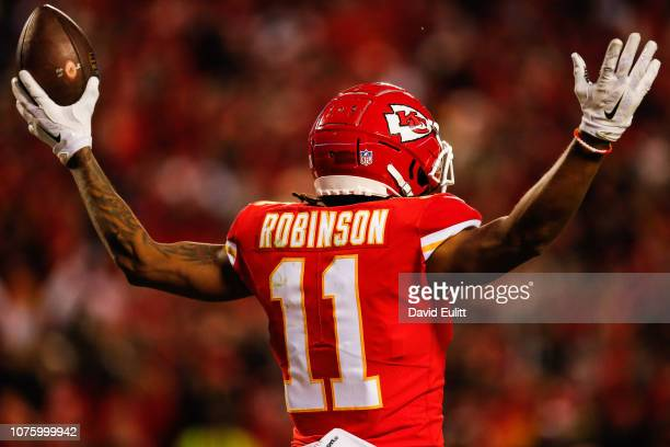 Demarcus Robinson of the Kansas City Chiefs puts his arms up after catching the fiftieth touchdown pass of the season for his quarterback Patrick...