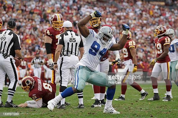 DeMarcus Ware of the Dallas Cowboys celebrates after sacking Rex Grossman of the Washington Redskins during the second half at FedExField on November...