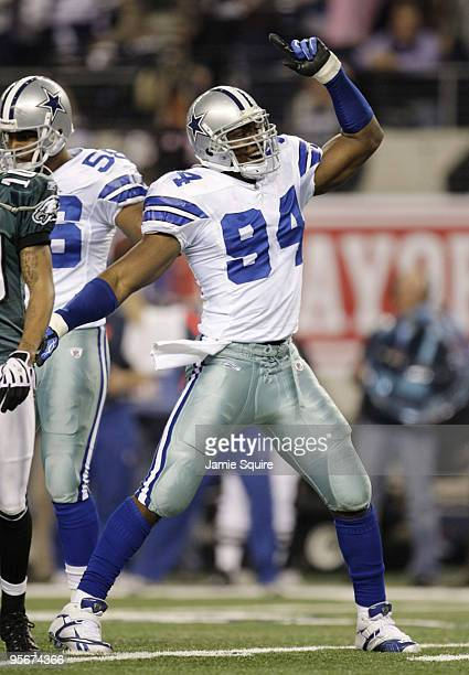 DeMarcus Ware of the Dallas Cowboys reacts after the Cowboys recovered a second quarter fumble by Michael Vick of the Philadelphia Eagles during the...