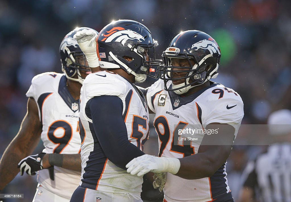 DeMarcus Ware #94 of the Denver Broncos celebrates with teammate Von Miller #58 in the third quarter against the Oakland Raiders at O.co Coliseum on November 9, 2014 in Oakland, California.