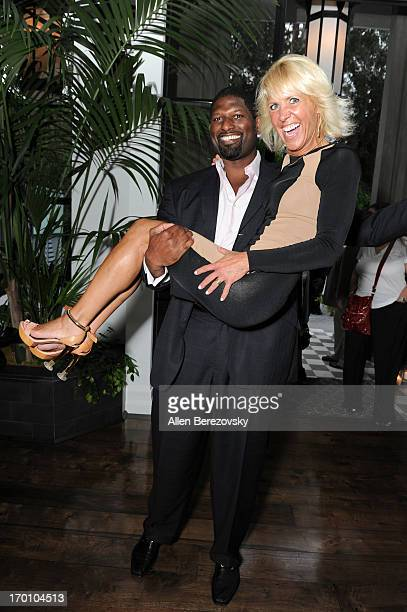 DeMarcus Williams and Debbie Heller attend Jeremy Renner's and Kristoffer Winters' celebration of the launch of Robb Report Home Style on June 6 2013...
