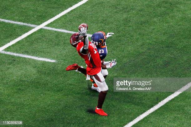 De'Marcus Ayers of the San Antonio Commanders makes a onehanded catch during the first quarter against Mark Myers Jr #23 of the Orlando Apollos in an...