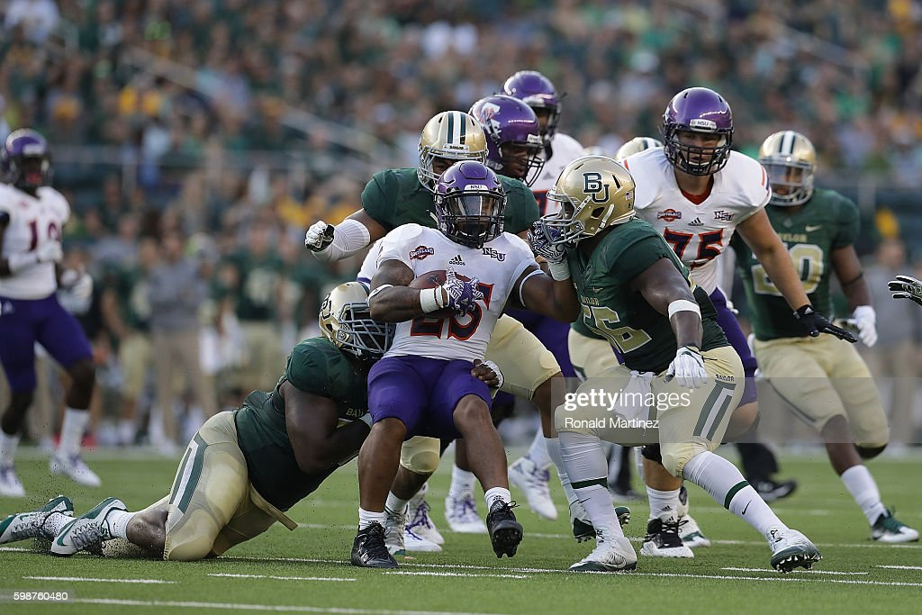 De'Mard Llorens #25 of the Northwestern State Demons is tackled by the Baylor Bears at McLane Stadium on September 2, 2016 in Waco, Texas.