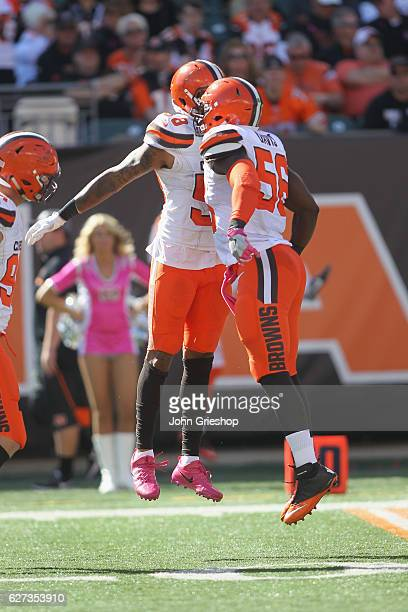 Demario Davis and Christian Kirksey of the Cleveland Browns celebrate a play during their game against the Cincinnati Bengals at Paul Brown Stadium...