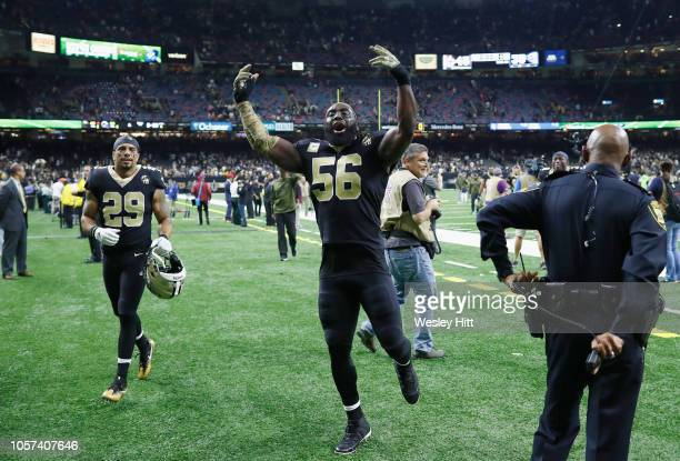 Demario Davis and Kurt Coleman of the New Orleans Saints celebrate defeating the Los Angeles Rams 4535 in the game at MercedesBenz Superdome on...