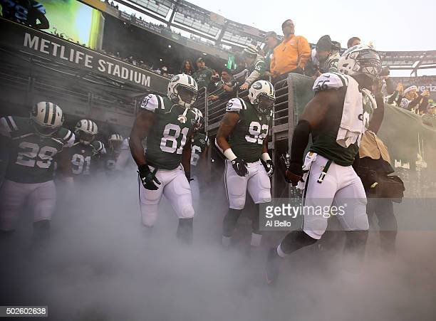 Demario Davis and Leonard Williams Quincy Enunwa of the New York Jets take the field prior to their game against the New England Patriots at MetLife...