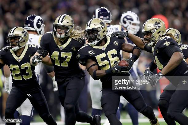 Demario Davis of the New Orleans Saints returns the ball after an interception against Jared Goff of the Los Angeles Rams during the first quarter in...